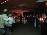 The newlyweds left through a tunnel of candles